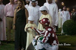 eslier giving goggles to young Al Nahyan