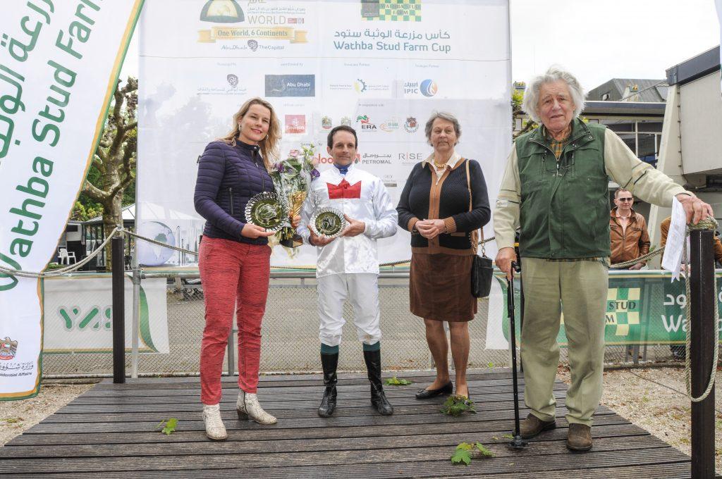 Winning owner and jockey trophies presented by Margreet de Ruiter