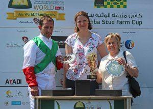 Simon Walker and Delyth Thomas receive trophies from Amanda Smith