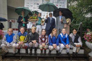 Lady jockey in the rain