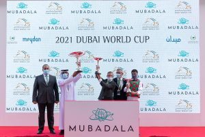 H.E Abdalla Al Marar, Didier Guillemin and Ioritz Mendizabal accept the trophies for the PA Group 1, Dubai Kahayla Classic, March 27, 2021 (Credit - DRC & Neville Hopwood)